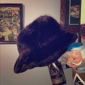 Beautiful like new brown faux fur hat with a brim